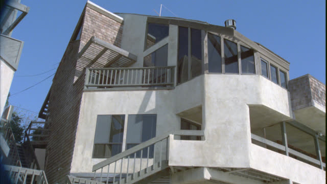 wide angle of contemporary upper class beach house. porches and balconies. - malibu stock videos & royalty-free footage