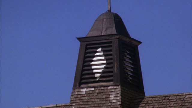 close angle of chimney or steeple on top of barn or church. - steeple stock videos & royalty-free footage