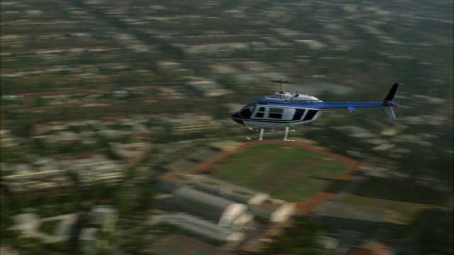 aerial of jet ranger helicopter over century city. commercial area. los angeles area. high rise office or apartment buildings. - 1985 stock videos & royalty-free footage