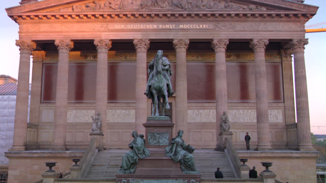 "wide angle of the old national gallery. ""der deutschen kunst"" or art museum. stone building with classical pillars or columns. staircases. bronze statues including one of frederick william iv on a horse. - kunst stock videos & royalty-free footage"