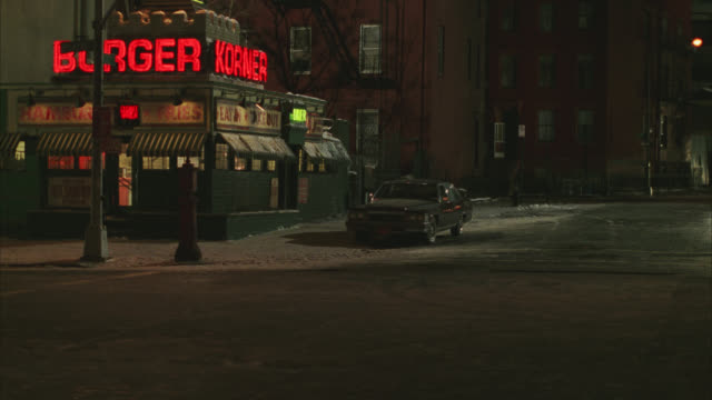 """wide angle of restaurant, """"burger korner"""" on city street in urban area. light snow on ground. fast food. - fast food stock videos & royalty-free footage"""