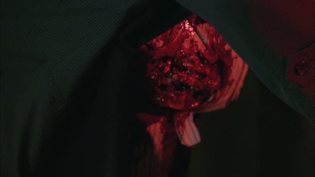 close angle bullet or gunshot wound in wounded man's stomach or abdomen. blood and gore. - gore stock videos & royalty-free footage
