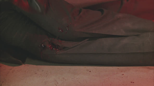 close angle of bullet or gunshot on man's knee while he is trying to slide himself across the floor. blood and gore. wounded. 36 fps. - gore stock videos & royalty-free footage