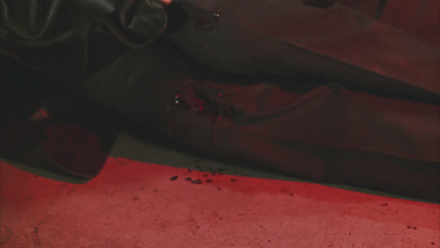close angle of bullet or gunshot on man's knee. he's lying on floor. blood and gore. wounded. 36 fps. - gore stock videos & royalty-free footage