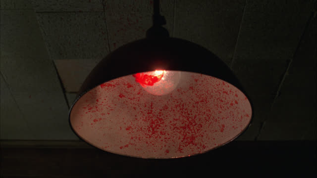 vídeos de stock, filmes e b-roll de up angle of blood splattered on industrial light or lamp suspended from ceiling. light bulbs. - electric lamp