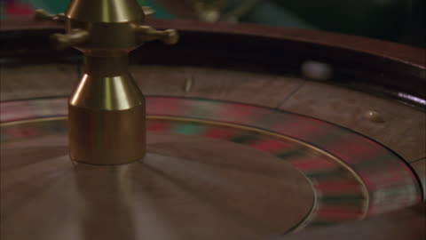 close angle of axe hitting spinning roulette wheel. gambling. could be part of a raid. - gambling stock videos & royalty-free footage