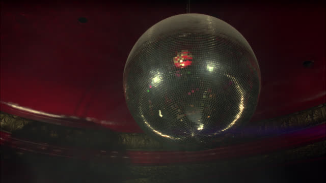 zoom in on lights reflecting off of disco ball in disco, dance or nightclub. - mirror ball stock videos & royalty-free footage