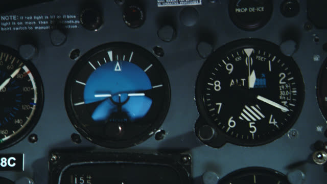 close angle of gauges, including altimeter, on control panel in cockpit of plane or aircraft. lights flashing, very shaky. could be during crash landing or emergency. - cockpit stock videos & royalty-free footage