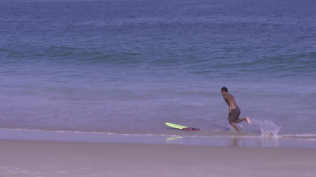 pregnant at the beach - skimboarding stock videos & royalty-free footage