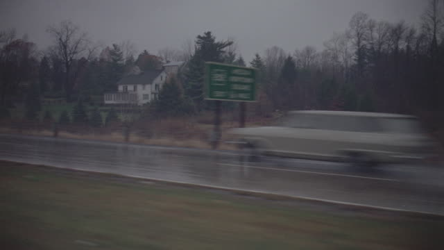 expressways: eastern (maryland) day: 3/4 back right- traveling fast through rolling eastern countryside; wet and rainy; fall season - wet wet wet stock videos & royalty-free footage
