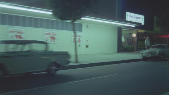 vidéos et rushes de auto bg: los angeles: nite: 3/4 back left on sepulveda blvd near lax - image animée