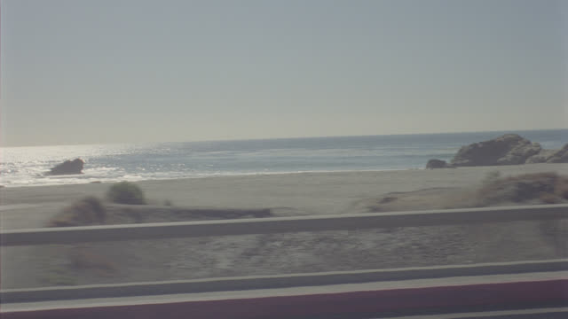 auto bg: malibu: calif. straight side right - pacific coast highway pch - traveling south ( reel_2_005.mov ) - malibu stock videos & royalty-free footage
