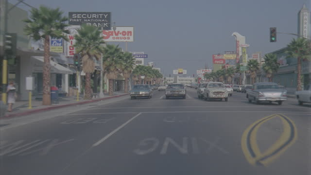 auto bg: studio city day: straight back - traveling west on ventura blvd from laurel canyon to coldwater canyon. normal speed(stock_footage_6_24_16_reel_7_002.mov) - moving process plate stock videos & royalty-free footage
