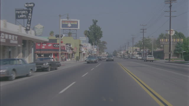auto bg: sherman oaks day: straight back - traveling west on ventura blvd. starting at coldwater canyon and ending at van nuys blvd. normal speed- light traffic (stock_footage_6_24_16_reel_7_003.mov) - driving plate stock videos & royalty-free footage