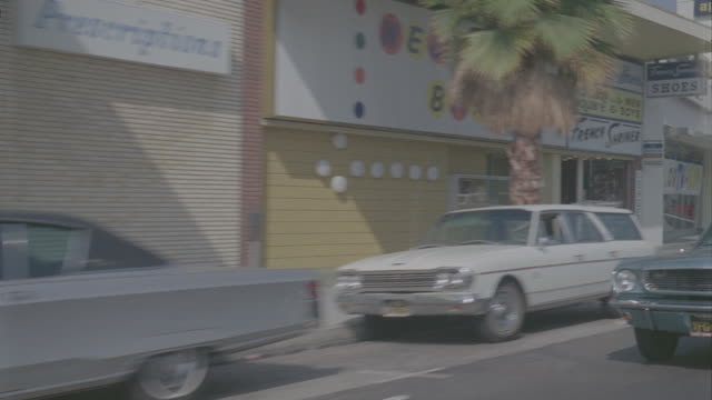 auto bg: studio city: day: 3/4 back left - traveling west on ventura blvd. starting at laurel canyon and ending at coldwater canyon. (stock_footage_6_24_16_reel_7_004.mov) - driving plate stock videos & royalty-free footage