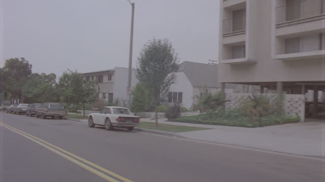 auto bg: los angeles: day: 3/4 back right - travels up sweetzer, crosses sunset blvd. passes attractive homes and into driveway where it stops. uphill all the way. (stock_footage_6_24_16_reel_8_004.mov) - driving plate stock videos & royalty-free footage
