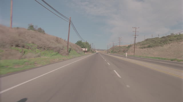auto bg: malibu: calif. straight back - pacific coast highway pch - traveling north (reel_2_001.mov ) - north pacific stock videos & royalty-free footage