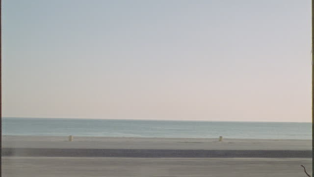 dusk: straight side traveling south on pacific coast highway in early evening, see the ocean and people on the beach - driving plate stock videos & royalty-free footage
