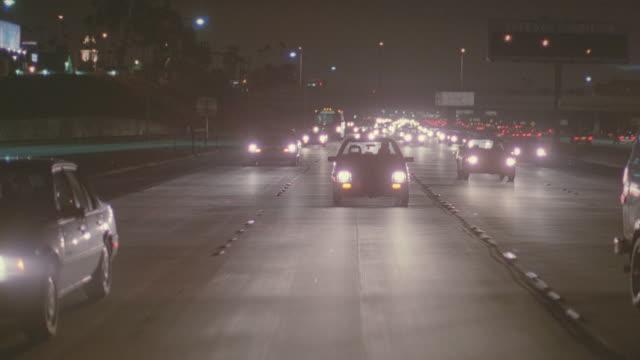 night: auto bg: straight back; santa monica, hollywood - moving process plate stock videos & royalty-free footage