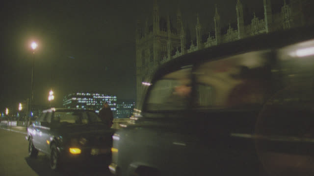 night: auto bg: london: 3/4 back right past big ben - driving plate stock videos & royalty-free footage