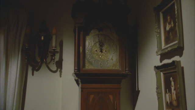 grandfather clock   11:58 hold on house interior     early victorian  slate in the middle  pan r-l to living room victorian furniture small girls bedroom single bed pink sheets light on nightstand table stairs - victorian stock videos & royalty-free footage