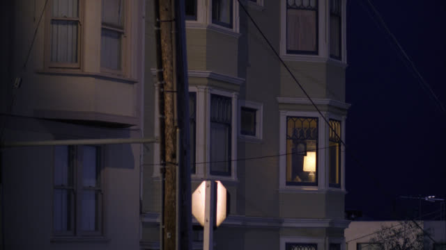 cu    harry's  sf victorian style apartment  house home townhouse three story middle class apartment condo  light on in room window  trolley by r-l - flat stock videos & royalty-free footage