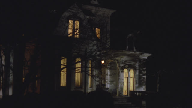 wide angle of upper class victorian gothic white three story mansion house at night. see interior lights turn off one by one. - 1992 stock videos & royalty-free footage