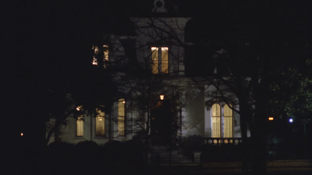 wide angle of upper class victorian gothic white three story mansion house at night. all inside lights turn off one by one. see tree in front yard. - 1992 stock videos & royalty-free footage