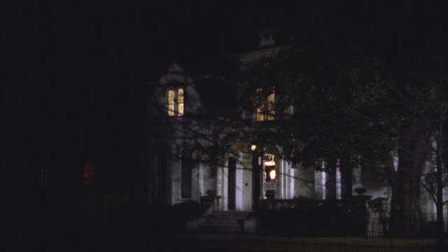 wide angle of upper class victorian gothic white three story mansion house at night. see upstairs interior lights on. see two downstairs lights turn on and off. - 1992 stock videos & royalty-free footage