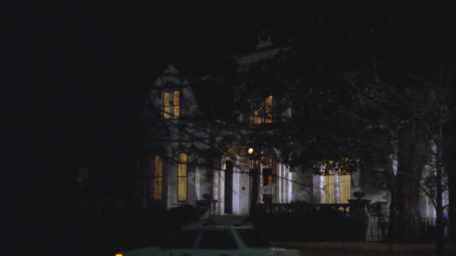 wide angle of upper class victorian gothic white three story mansion house at night. see car drive by right to left. - 1992 stock videos & royalty-free footage