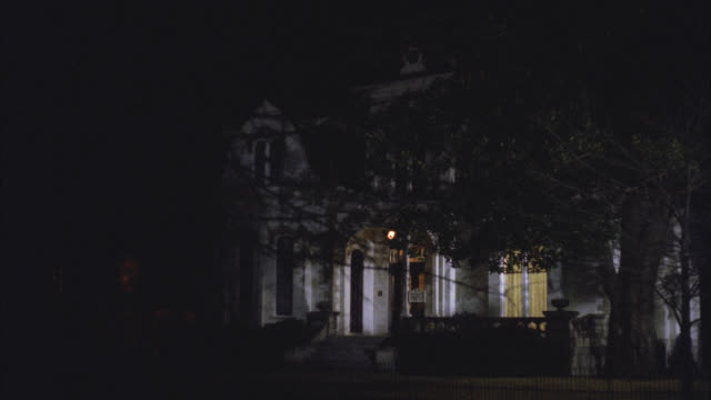 wide angle of upper class victorian gothic white three story mansion house at night. see trees in front yard. - 1992 stock videos & royalty-free footage