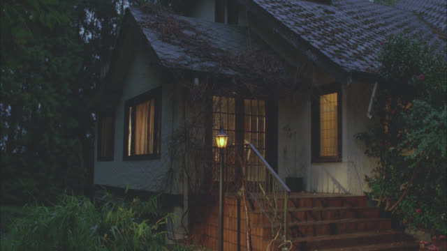 rustic cottage little house country rural setting  one story   inn bed and breakfast  people moving inside house has match matching dx is 1613-g - staircase stock videos & royalty-free footage