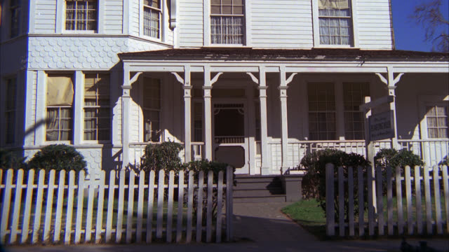 building      house two story white frame house white picket fence out front - picket fence stock videos & royalty-free footage