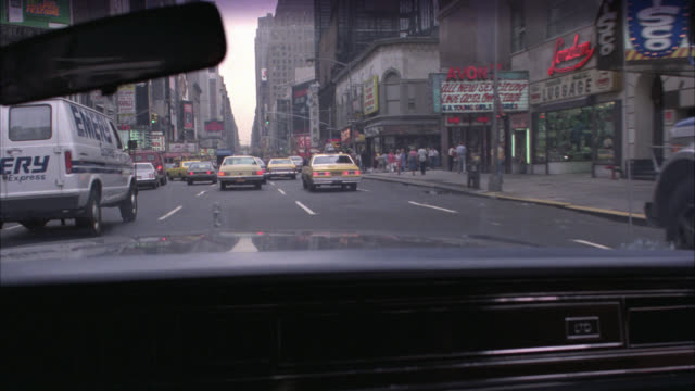 vehicles / int car  / car pov / various shots of times square , thru car windshield / - times square manhattan stock videos & royalty-free footage