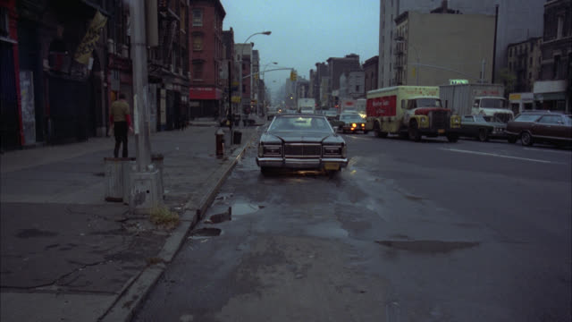 limousine runby to fg  ms to establish subway entrance   stops   eischied gets out and walks to subway entrance lower class graffiti - 1977 stock videos & royalty-free footage