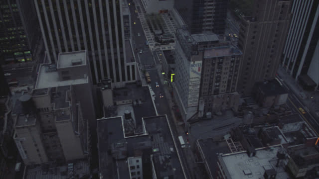hi-down angle to new york street, pan up cmi to office building windows.  high angle down - 1983 stock videos & royalty-free footage