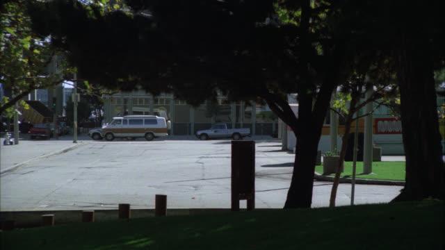 ls / pan harry's cadillac r-l , past bay bridge , along shoreline/ - san francisco oakland bay bridge stock videos & royalty-free footage