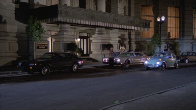 """est """" standford hotel """" entrance / upper class / cars parked in front of hotel / street lamps street lights are on / people entering and exiting the hotel / light city traffic by - stereotypically upper class stock videos & royalty-free footage"""