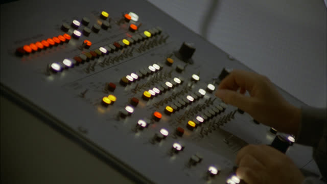 shot from left side - vintage 1970's 1980's computer console insert of hands typing turning knobs buttons keys levers switches [shots 1230-01 to 1231-01 match] - control room stock videos & royalty-free footage