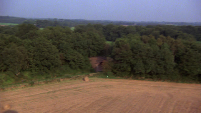 aerial      a-g      along railroad tracks thru english countryside might work for farm land farmlands country side trees - 1985 stock videos & royalty-free footage
