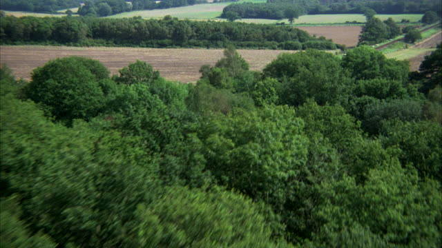 aerial     a-g    over english countryside along railroad tracks    country side might work for farm land farmlands - railway track stock videos & royalty-free footage