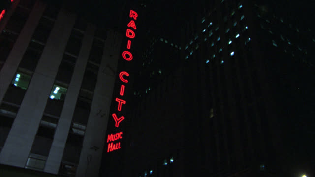 """points of interest/ """"tilt up angle on radio city music hall"""" / two angles / - radio city music hall stock videos & royalty-free footage"""