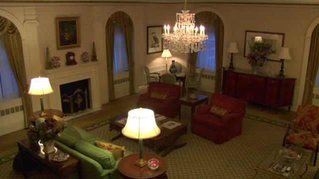 high angle down of upper class living room or sitting area. could be mansion, estate, or hotel. chairs, couches, fireplace, and chandelier visible. - 2013 stock videos & royalty-free footage