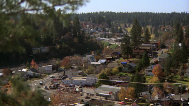 high down to small town up in northern california   static   farm town community neighborhood  residential rural area with forest pine trees in bg / neg cut to main street with stores cars people pedestrians activity - small town stock videos & royalty-free footage