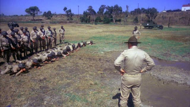 soldiers army marines in the field exercising performing drills shooting crawling with guns weapons commander watches over the men - 1978 stock videos & royalty-free footage