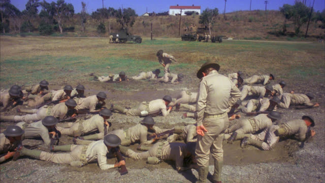 soldiers army marines in the field exercising performing drills shooting crawling with guns weapons commander watches over the men and yells at one soldier who stops soldier gets angry and attacks punches the commander. action. - 1978 stock videos & royalty-free footage