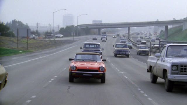 process plate of cars moving towards pov on highway or freeway. see red convertible classic porsche. see various cars. pov from back of moving vehicle. - 1985 stock videos & royalty-free footage