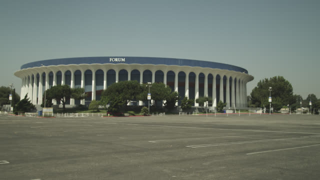 wide angle of the forum stadium or arena. parking lot partially visible. - auditorium stock videos & royalty-free footage