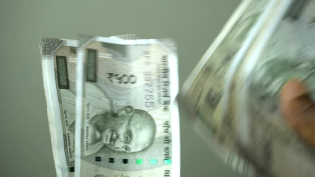indian men counting indian currency - loan stock videos & royalty-free footage