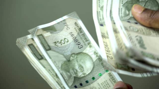 indian men counting indian currency - counting stock videos & royalty-free footage